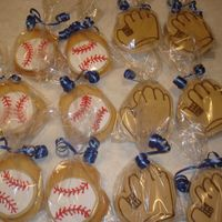 Baseball And Mitt Sugar Cookies   These cookies were made for my daughters t-ball team. Each bag contained a baseball and mitt cookie.