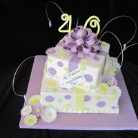 "Fabulous Forty  An 8"" and 12"" Vanilla cake with buttercream icing, fondant accents, gum paste gerber daisies, bow, gift card and numbers. A bit..."