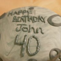 John's 40Th B-Day Chocolate cake with choclate buttercream iceing.Fondent with black coloer added to make it gray. Second fondent cake, first over the hill...