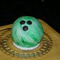 Bowling Ball Bowling ball cake made for a childs bowling birthday party/ The bowling ball is covered with butter cream frosting that is marbled. The...