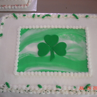 Shamrock The Shamrock and the green marble are made with fondant and the cake was iced in butter cream.