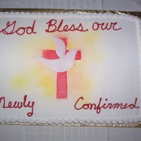 Confirmation Cake I made for my daughters confirmation group. The cross was a stencil I made and the dove was made out of fondant. I used butter cream...