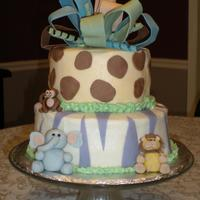 Pastel Baby Safari Cake Buttercream with fondant accents.