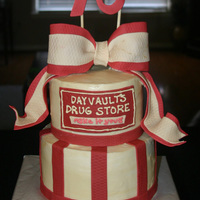 70Th Birthday This cake was made for a woman who grew up in her father's drug store. I replicated the sign from the old drug store from fondant and...