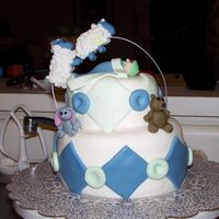 "Counting Sheep Baby Shower Small cake, 6"" and 4"" layers, covered in MMF. The sheep are made from a gumpaste/fondant mixture. Thank you to the cakes on cake..."