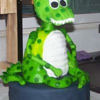 "Dinosaur Birthday Cake 10"" cake covered in Marshmallow fondant, with wondermold dinosaur body. The head is styrofoam, due to the heaviness."