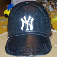 Ny Yankees Hat Chocolate cake, iced in ganache, covered in MMF. Thanks to everyone for the great ideas!