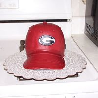 "Bulldogs Hat Another hat cake! These go together so easily! 6"" oven proof bowl, on top of a 6"" round layer, all covered in MMF. Go Dawgs!"