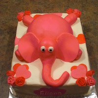 Elephant Sheet cake iced in BC with MMF accents. Elephant is made out of sports ball pan and covered in MMF.