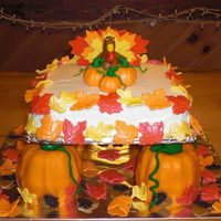 Thanksgiving Square cake is BC with MMF accents. Bottom pumpkins are MMF.