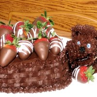 Beary Chocolate Cake Chocolate Basket Cake with strawberry filling and handdipped Chocolate covered Strawberries on top. First time making a basket looking cake...