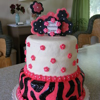 Pink And Black Buttercream Icing with black sparkle gel for the stripes. Flowers are made of GP.
