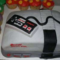 Nes Cake I made this cake for a friends birthday, I don't think its half bad for my second use of fondant. No one would even cut it so I had to...