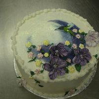 Cake_For_Final.jpg Lemon cake, frosting and filling. Overlaping Cresents were airbrushed, RI flowers and Humming bird is BC transfer. This is the cake I did...