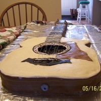 Taylor Guitar Cake  Guitar carved to look like my brother-in-laws cake...Special Strawberry Cake covered in Buttercream and accents were mmf..strings were...