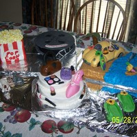 Mixture Of Things Liked  Birthday cakes for my two nieces...they wanted a combination of things they like...Popcorn and reel..were Strawberry cake covered in...