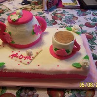 Mothers Day Cake  This cake was for my mom for Mothers Day... she loves her coffee so I carved a Strawberry Cake for the teapot and baked a cake in a coffee...