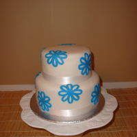Blue Flowers A 10 and 8 inch fondant covered cake with blue fondant flowers.