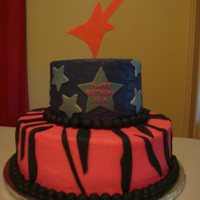 Rock Star 10 and 6 inch tiers buttercream with fondant accents