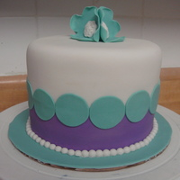 Retromodern Made this cake for fun, wanted to try out my new purple elite fondx, pearl bead maker, and brooch/button mold :D WASC cake with vanilla...