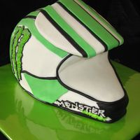 "Dirtbike Helmet Carved from a 10"" and 2 8"" cakes. The visor is fondant covered cardboard."