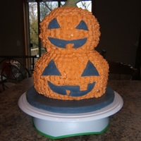 First Halloween Cake I used two 8' cakes and two 6' cakes. Stacked them and carved out the round shape of the pumpkins. Then used tip #21 for the...