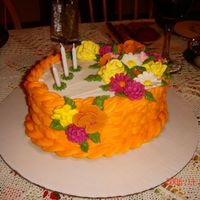 Thanksgiving Holiday Centerpiece   Centerpiece made for Thanksgiving Holiday dinner in fall colors. Flowers made with royal icing. Basketweave with buttercream icing.