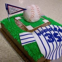 Cubs Baseball Cake decorated for a cubs fan. Jersey made out of fondant, baseball out of rice krispies covered in fondant.