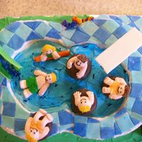 Birthday At The Water Park Cake made to look like a pool with a waterslide and diving board, made out of gumpaste. The kids were piped out of buttercream on to little...