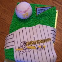 Sidewinders Baseball Cake decorated in buttercream to look like grass. Jersey made out of fondant. Baseball formed out of Rice Krispies and covered in fondant...