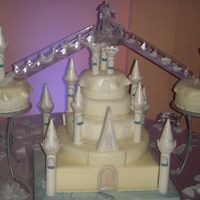 Castle Wedding Cake Cake covered with mm fondant. Turrets and peaks from Wilton's Romantic Castle Cake Set also covered with fondant and decorated with...