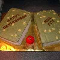 Teachers Retirement Book Cake   Made for a retiring teacher. One book is Chocolate WASC and the other is Yellow WASC. Iced in Buttercream. The apple is fondant.