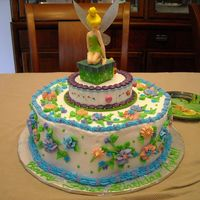 Tinkerbelle First Birthday Cake  I made this cake for my cousin's daughter's first birthday. It was chocolate cake with Italian Cream filling and vanilla...