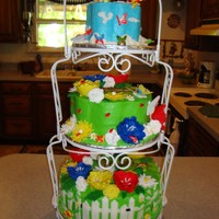 Garden Party Baby Shower  My cousin wanted a very bright baby shower cakes. No pastels. The bottom is Chocolate Carmel Cake, vanilla buttercream filling. The top two...