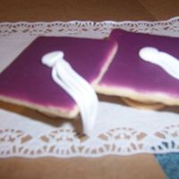 Graduation Cap Cookies Two small rounds with a square on top. Fondant tassel.Not a very good picture. Made these quickly when I found out the graduation committee...