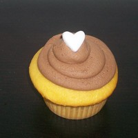 Simple Valentine's Cupcakes Yellow cake with chocolate icing...just simple and good!