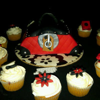 Red Purse Cake And Cupcakes Red Purse cake, all edible. fondant covering and gumpaste buckle. Mini purses and flowers made of fondant