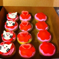 Hello Kitty Cupcakes Cupcakes to topper cake, all hand cut and decorated...buttercream and MMF