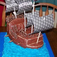 Pirate Ship Birthday Cake Chocolate pirate ship on french vanilla sheet cake...for my son's 7th birthday.