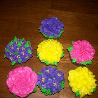 Flower Cupcakes   WASC cupcakes, filled with Italian cream, iced in buttercream ....just practicing my flower cupcakes.