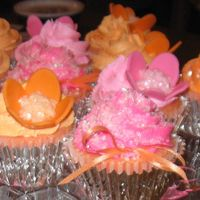 Pink And Orange Cup Cakes MMF flowers with butter cream icing and sugar sprinkles. Strawberry cup cakes filled with cream cheese and marshmallow fluff blended...