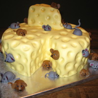 "The Mice And The Cheese Three layer 12"" cake with 30 fondant mice. This was for a 30th birthday party that was canceled last minute because of sick kids."