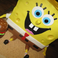 Spongebob This is a 6 layer WASC. I used three 8 x 8 square cakes cut it in half and started stacking. It's covered in MMF and the crabby patty...