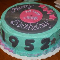 Fabulous 1952  BC frosting, italian cream cake, double layer, record, numbers, and star accents all fondant. Some are dusted with shimmering dust. This is...