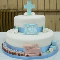 Baptism/christening W/ Train This cake was inspired by so many others on this site. I took a little bit from several different ones I saw and pieced them all together....