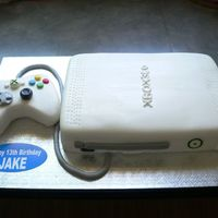X-Box 360 This was my first x-box cake. Everything is fondant (controller was Rice Krispy treats, console was cake), and everything was covered in...
