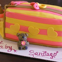 Girl Baby Shower Cake Diaper bag cake made w/ bc covered in fondant. Bottle, diaper and bear are fondant sculptures.