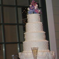 White Stacked Wedding Cake Son, Billy's, wedding cake. White on white buttercream icing with fresh flowers on top. Top tier, hand piped hearts; 2nd tier, fondant...
