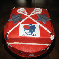 High School Lacrosse Cake marshmallow BC with gum paste decorations, hand painted logo, airbrushed on red to BC and used paper towel to swirl emboss design