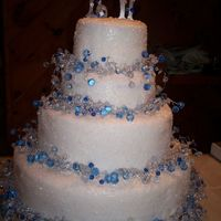 Winter Wonderland   White foundant covered with sugar crystals and blue crystal garland